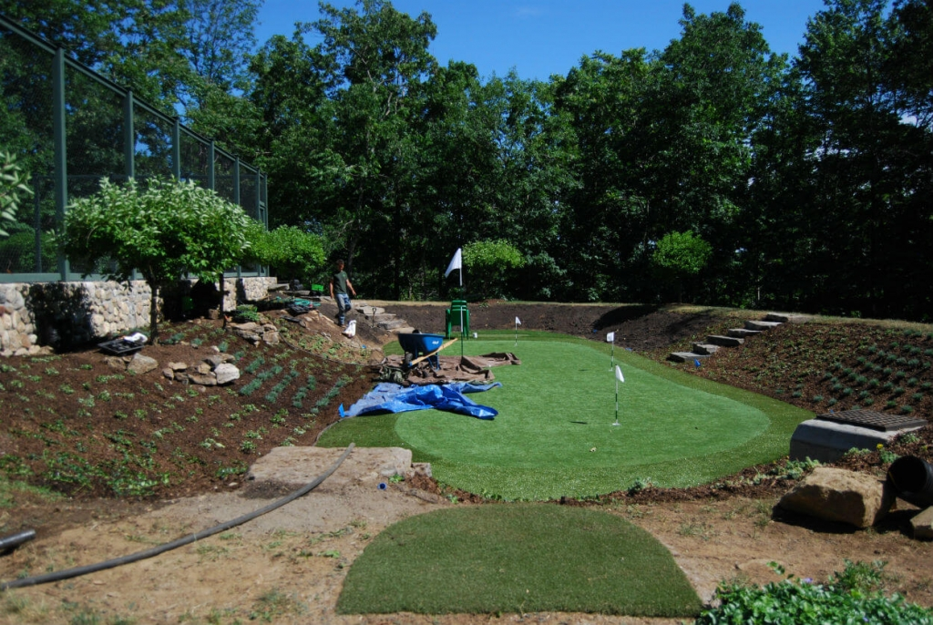 putting green installation by tennis court on organically landscaped property waccabuc westchester county ny